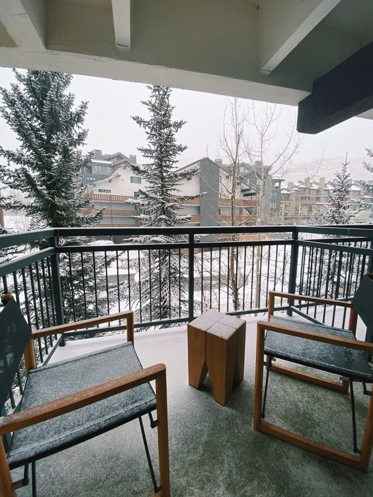 Balcony view of snow and trees at the Vail Marriott Mountain Resort in Lionshead