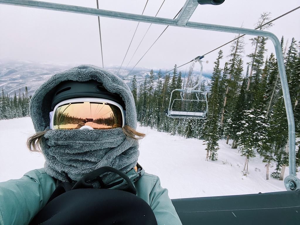 snowboarder on a ski lift in Beaver Creek Ski Resort