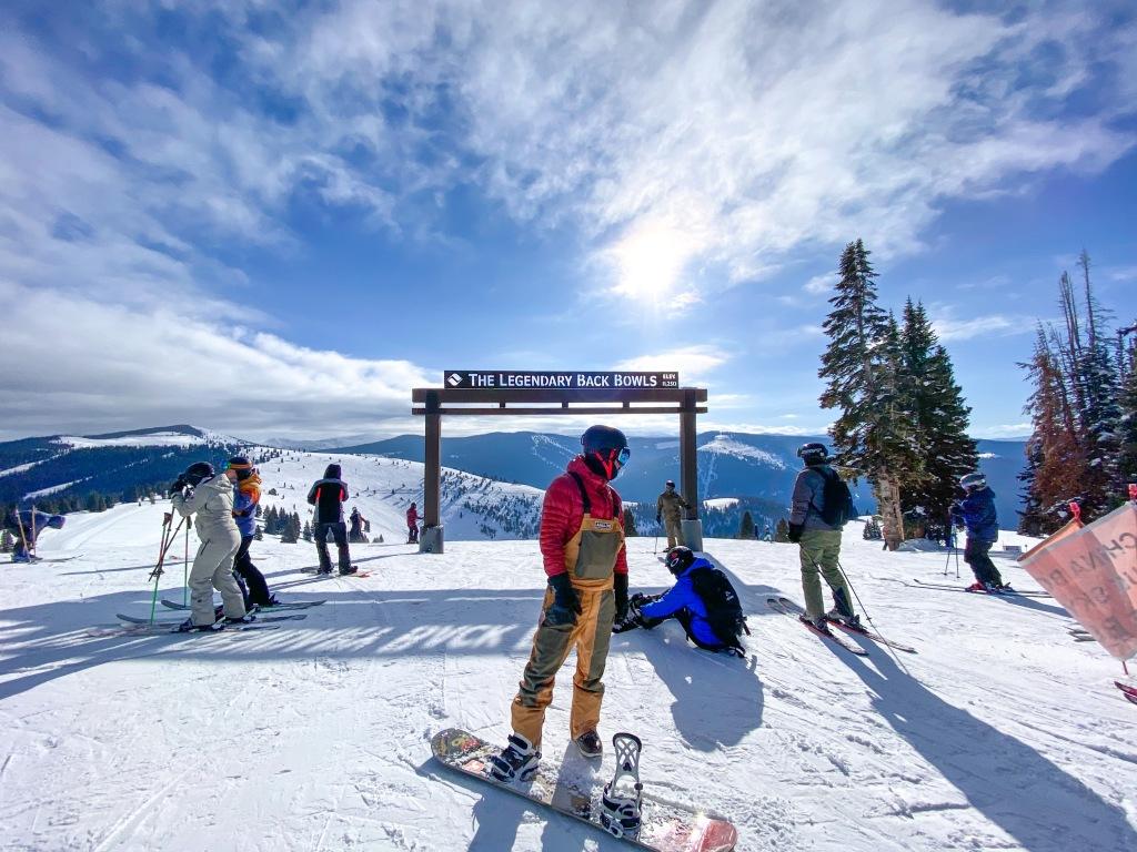 snowboarder at the back bowls in vail ski resort